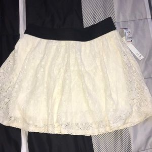 cream colored laced flowy skirt